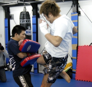 Gomi striking the mitt in his gym. - GBRing.com